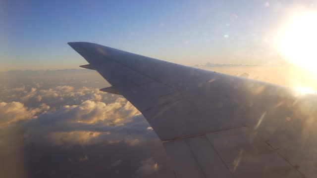 view of the clouds from airplanes window during the flight - corporate jet stock videos & royalty-free footage