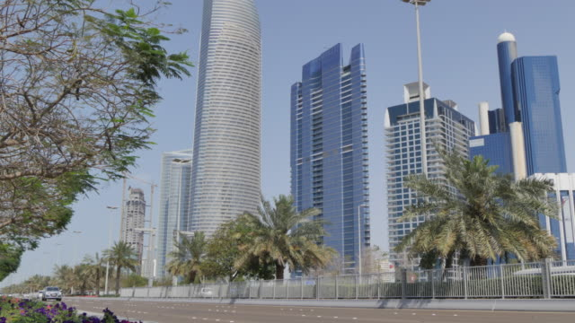 view of the corniche road to the landmark building, abu dhabi, united arab emirates, middle east, asia - famous place stock videos & royalty-free footage