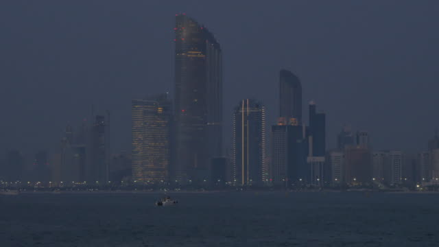 View of the Corniche to the Landmark Tower at sunset, Abu Dhabi, United Arab Emirates, Middle East, Asia