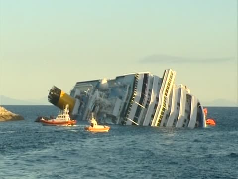 view of the costa concordia after the cruise ship capsized off the coast of isola di giglio - capsizing stock videos & royalty-free footage