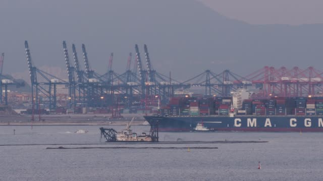 view of the cranes and containers on busan new port in geoje island - lastkahn stock-videos und b-roll-filmmaterial