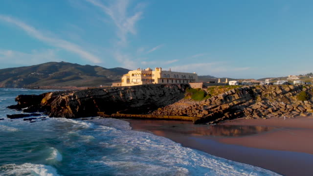 view of the crismina beach and guincho beach with the sintra mountain in the background - leite stock videos and b-roll footage