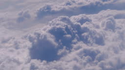 View of the Curly Clouds from the Window of the Plane
