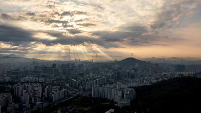 view of the downtown district near n seoul tower with tyndall phenomenon - light natural phenomenon stock videos & royalty-free footage