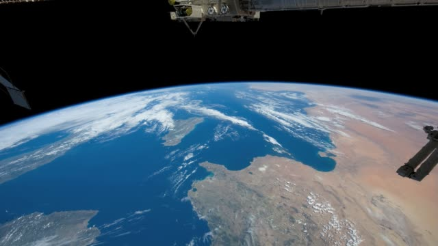 / view of the earth from the international space station / passes from the tyrrhenian sea, east of spain, to central libya. view from tyrrhenian sea... - mediterranean sea stock videos & royalty-free footage