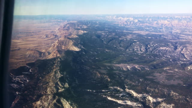 view of the eastern side of the bookcliff mountain range (a part of the rocky mountains) in the high desert in western colorado on a sunny day - reforestation stock videos and b-roll footage