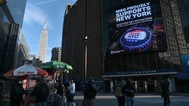 """view of the empire state building and a large digital billboard that reads """"msg proudly supports new york election day voting now"""" on election day... - joe 03 stock videos & royalty-free footage"""