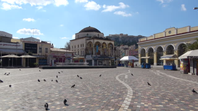 view of the empty monastiraki square due to the ban, with the acropolis in the background, which is normally one of the most busy areas in the... - athens greece stock videos & royalty-free footage