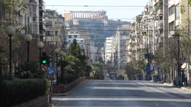 view of the empty patision avenue due to the ban, with the acropolis in the background, which is normally one of the most busy areas in downtown... - athens greece stock videos & royalty-free footage