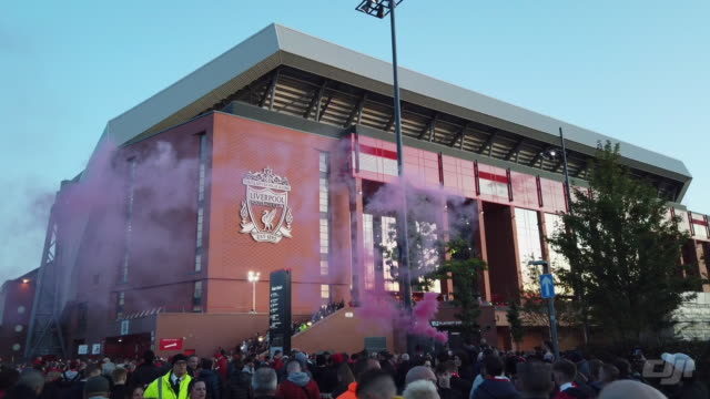 a view of the entrance to the main stand at anfield and a flare going off before the premier league match between liverpool fc and brighton and hove... - バッジ点の映像素材/bロール