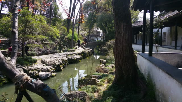 view of the famous humble administrator's garden on march 27, 2017 in suzhou, china. the humble administrator's garden is a unesco world heritage... - classical chinese garden stock videos & royalty-free footage