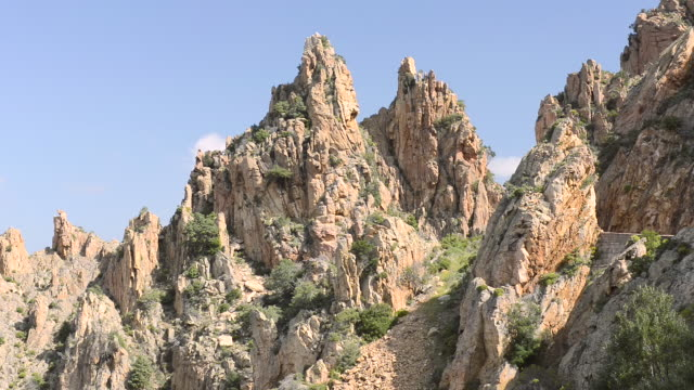 ws view of the fantastic rock landscape of the calanche of piana, unesco world heritage site / gulf of porto, corsica, france - igneous stock videos & royalty-free footage
