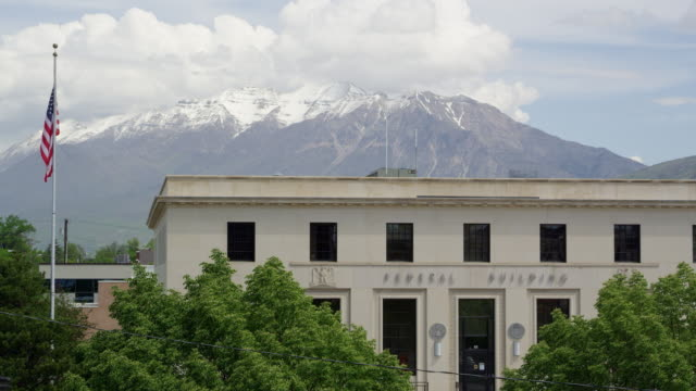 View of the Federal Building  in Provo Utah as flag moves in the breeze