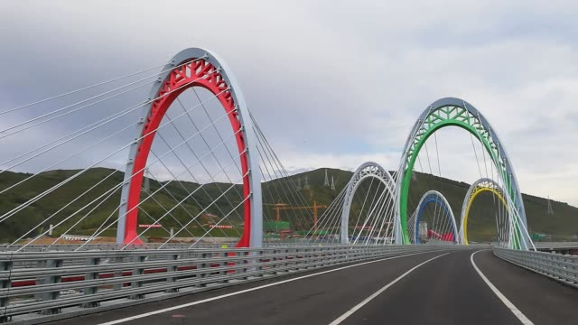 a view of the five rings bridge built in celebration of the 2022 winter olympics on september 6 in zhangjiakou hebei province of china - bridge built structure stock videos & royalty-free footage