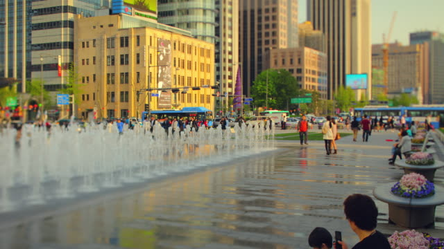view of the fountains in gwanghwamun square (famous tourist attraction) - courtyard stock videos & royalty-free footage