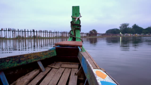 View of the front of the boat at U Bein Bridge in Mandalay, Myanmar in the evenning