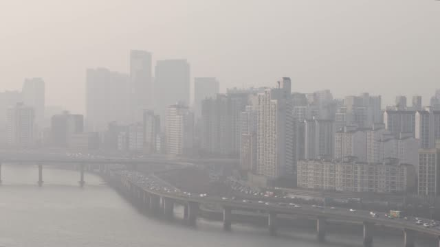 view of the gangbyeonbungno highway and city buildings in fine dust and yellow dust, seoul - smog stock videos & royalty-free footage