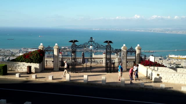 view of the gate of the shrine of the bab on mount carmel in haifa - haifa stock videos and b-roll footage