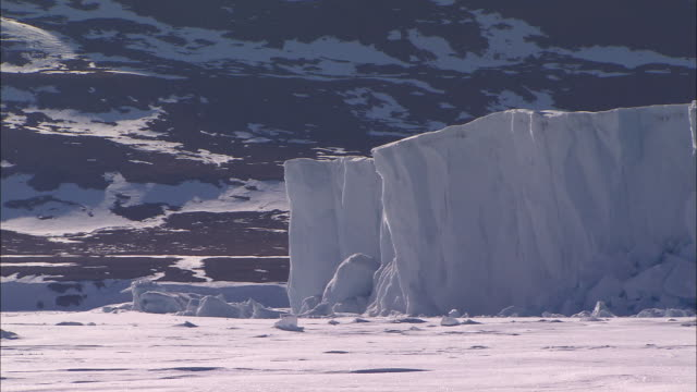 view of the glacier on the snow-covered ground in the north pole - north pole stock videos & royalty-free footage