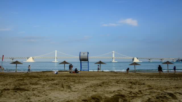 view of the gwangandaegyo bridge at the gwangalli beach - lifeguard chair stock videos & royalty-free footage