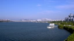 A view of the Han River in Seoul with a yacht and a dock.