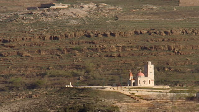 view of the heart of jesus church in the mountains above bsharri. - christentum stock-videos und b-roll-filmmaterial