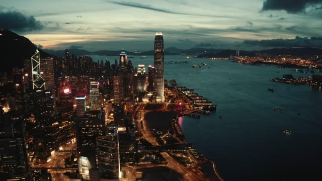 view of the hong kong at sunset - victoria harbour hong kong stock videos & royalty-free footage