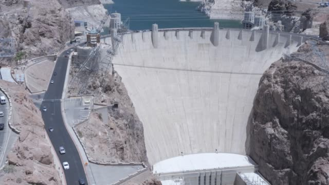 view of the hoover dam from the mike o'callaghan-pat tillman memorial bridge, nevada/arizona border, united states of america, north america - hoover staudamm stock-videos und b-roll-filmmaterial