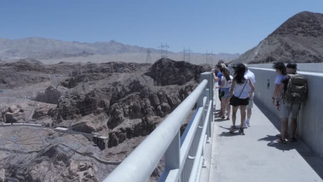 view of the hoover dam from the mike o'callaghan-pat tillman memorial bridge, nevada/arizona border, united states of america, north america - clark county nevada stock videos and b-roll footage
