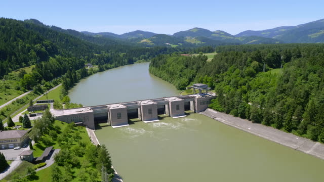 aerial view of the hydroelectric power plant on drava river in vuzenica - hydroelectric power stock videos & royalty-free footage