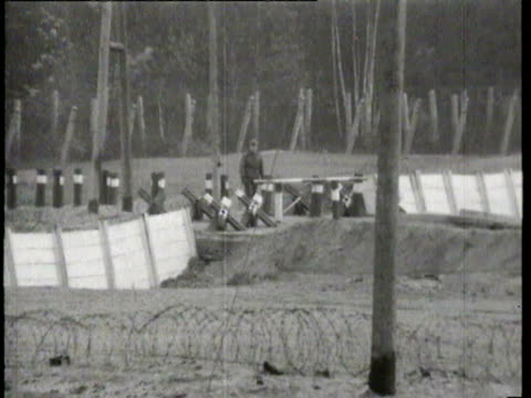 view of the inner berlin wall on outskirts of berlin / barriers / east german guards / houses along the border of west berlin being demolished /... - guarding stock videos & royalty-free footage