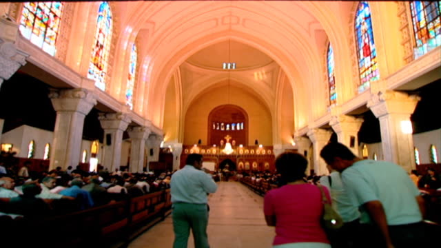 view of the inside of st. mark's coptic orthodox cathedral in cairo with worshippers filling the pews. coptic christians make up 10-15 percent of the... - apse stock videos & royalty-free footage