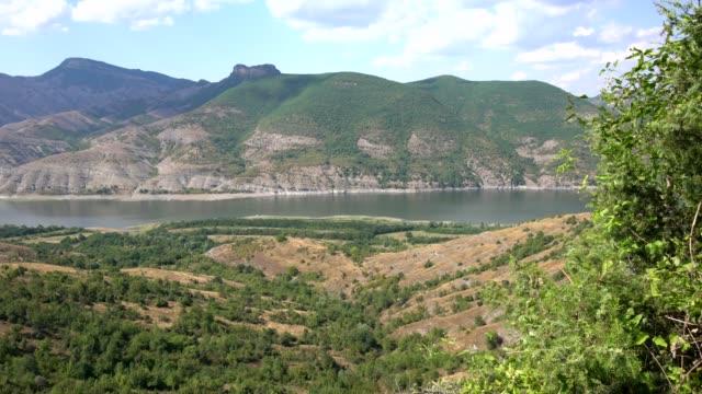 view of the kardzhali (kardzali) reservoir in eastern rhodopes, bulgaria view of the kardzhali (kardzali) reservoir in eastern rhodopes, bulgaria - 1963 stock videos & royalty-free footage