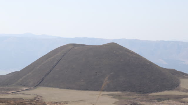 a view of the kome zuka in the vast caldera of mt aso the largest volcano in japan still active - caldera stock videos and b-roll footage