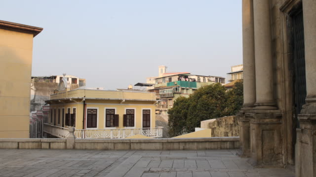 view of the local colonial architecture seen from the front terrace at the ruins of st paul's. officially known as the macao special administrative... - 聖ポール天主堂跡点の映像素材/bロール