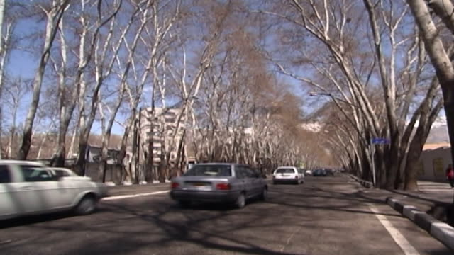 view of the longest street in the middle east, tehran's tree-lined valiasr street divides the metropolis into east and west. - lunghezza video stock e b–roll