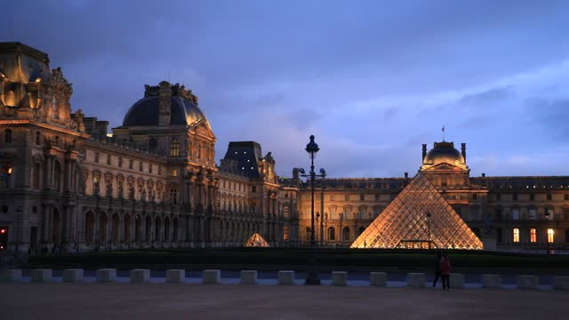 view of the louvre pyramid at dusk without any tourists on january 7, 2021 in paris, france. unlike the united kingdom or germany, the french... - atmospheric mood stock videos & royalty-free footage