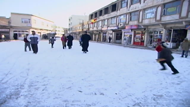 view of the main road in midyat in winter - winter stock videos & royalty-free footage