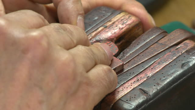 view of the making process of wood seal in korean traditional way - seal stamp stock videos and b-roll footage