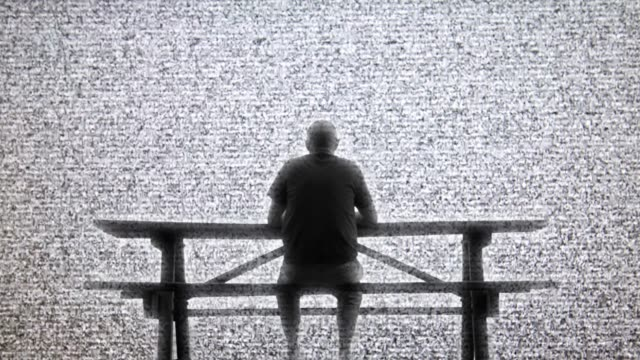 view of the man sitting on the bench and watching sky filled up with tv static. - radiation stock videos & royalty-free footage