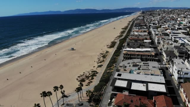 view of the manhattan beach pier after it was closed amid the coronavirus pandemic on march 27, 2020 in manhattan beach, california. los angeles... - venice california stock videos & royalty-free footage