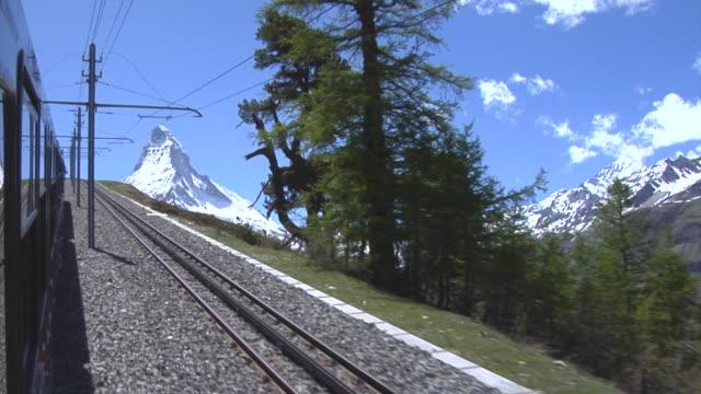 View of the Matterhorn and a train of the Gornergrat railway