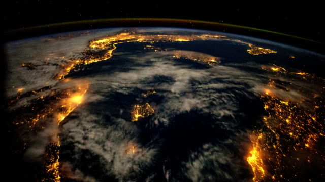 vídeos de stock e filmes b-roll de iss view of the mediterranean and europe at night: planet earth from above - imagem de satélite