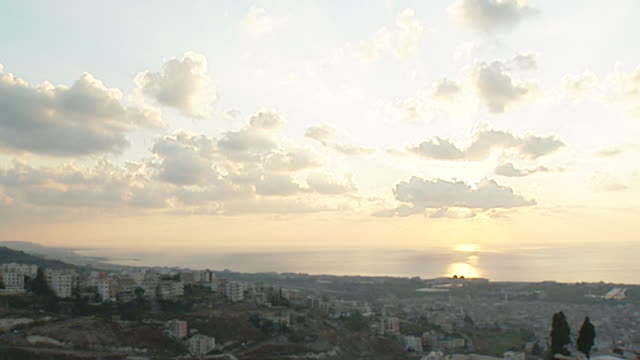 view of the mediterranean coast and the city of saida taken from the mieh mieh palestinian refugee camp, at sunset. - palestine liberation organisation stock videos & royalty-free footage