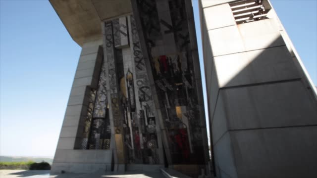 view of the monument to 1300 years of bulgaria, also known as the founders of the bulgarian state monument near shumen - kommunismus stock-videos und b-roll-filmmaterial