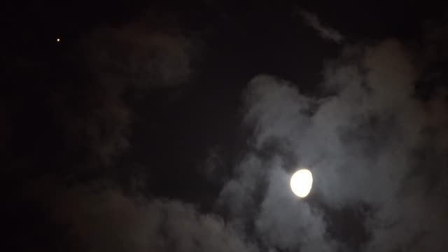 view of the moon shines together with mars on august 9, 2020 in bayingolin mongol autonomous prefecture, xinjiang uygur autonomous region of china. - sky stock videos & royalty-free footage