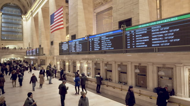 view of the mta metro-north railroad schedules ticket counter at the grand hall of grand central station in manhattan new york city during the... - ticket counter stock videos & royalty-free footage