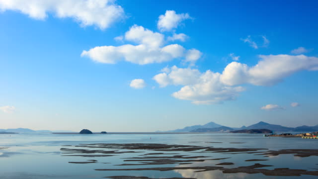 view of the mud flat under the clouds in incheon - mud flat stock videos and b-roll footage