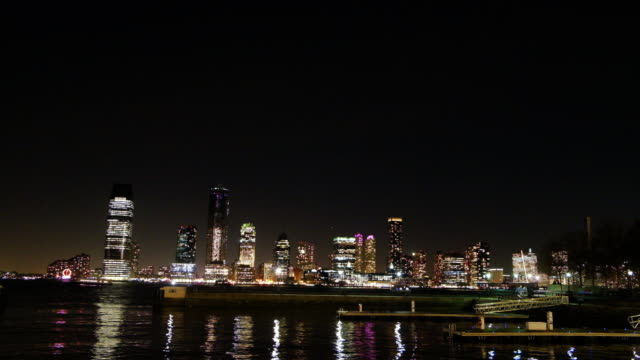 view of the new jersey skyline from downtown manhattan at night. - naga river stock videos and b-roll footage