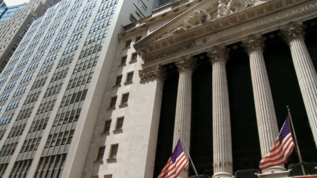 ms pan view of the new york stock exchange  / new york city, new york state, usa   - new york stock exchange stock videos & royalty-free footage